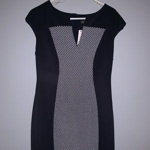 Sheath style. Navy w white dot pattern down middle